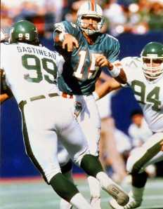 Miami Dolphin quarterback Kyle Mackey throws against the rush by NY Jets defensive end Mark Gastineau during the 1987 season. Mackey is a former National Football League player who played for the Miami Dolphins during the 1987 players strike and later played for the New York Jets. Tuesday, April 26, 2011. Valentino Mauricio/The Enterprise