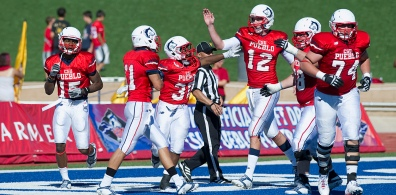 Colorado State University-Pueblo players celebrate after a touchdown against Western New Mexico in Pueblo, Colo. on Sept. 21, 2013. CSU-Pueblo won 44-7 in their season home opener. (Chris McLean, The Pueblo Chieftain)